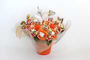 Sweets Arrangement Flower Arrangement made from candy on white