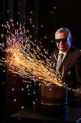 (2011GLOBE100) Oxford, MA 050311 IPG Photonics CEO Valentin Gapontsev (cq) photographed at the company's headquarters in front of  a 20,000- watt fiber laser cutting through a 1/2 inch low- carbon steel.   (Essdras M Suarez/ Boston Globe)/ BIZ