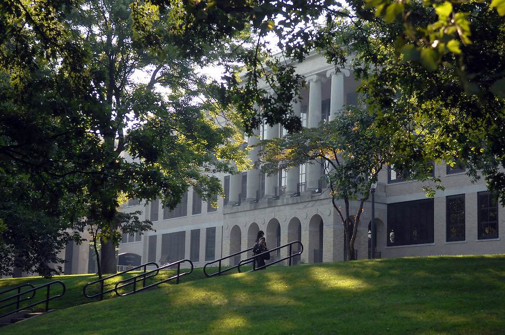 A student walks up the stairs leading to Kent Hall on the front campus area of Kent State Universtiy.<br /> <br /> Photo By Bob Christy<br /> August, 2007<br /> Fall, student, horizontal