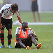Bakaye Traoré, feels an injury during training with AC Milan in preparation for the Guinness International Champions Cup tie with Chelsea at MetLife Stadium, East Rutherford, New Jersey, USA.  3rd August 2013. Photo Tim Clayton