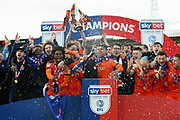 CHAMPIONS Luton Town players and coaching staff celebrate winning the league title after the EFL Sky Bet League 1 match between Luton Town and Oxford United at Kenilworth Road, Luton, England on 4 May 2019.