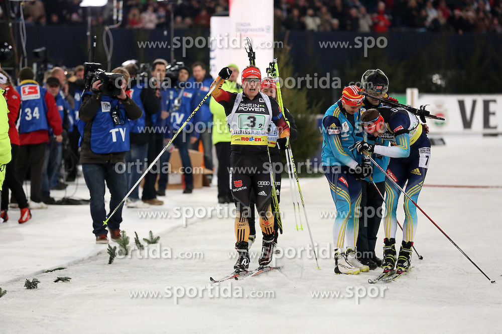 28.12.2013, Veltins Arena, Gelsenkirchen, GER, IBU Biathlon, Biathlon World Team Challenge 2013, im Bild Florian Graf (Deutschland / Germany) jubelt ueber den Sieg mit Olena Pydrushna (Ukraine), Andriy Deryzemlya (Ukraine) enttaeuscht daneben // during the IBU Biathlon World Team Challenge 2013 at the Veltins Arena in Gelsenkirchen, Germany on 2013/12/28. EXPA Pictures &copy; 2013, PhotoCredit: EXPA/ Eibner-Pressefoto/ Schueler<br /> <br /> *****ATTENTION - OUT of GER*****