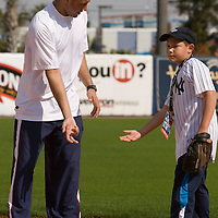 """Jordan Boone (L) talks baseball with the New York Yankee's Derek Jeter during the Upper Deck, """"Play Ball! with Derek Jeter"""" clinic on Saturday, February 10, 2007 at Legends Field in Tampa, Florida.   Justin Topa, 15, of Binghampton, New York, Jordan Boone, 10, of Las Vegas, Nevada, Bryce Porter, 10, of Costa Mesa, California and Gavin Leonard, 9, of Bristol, Virginia, each won the grand prize to meet Jeter through various promotions on www.UpperDeckKids.com in 2006 .UPPER DECK/Scott Audette"""