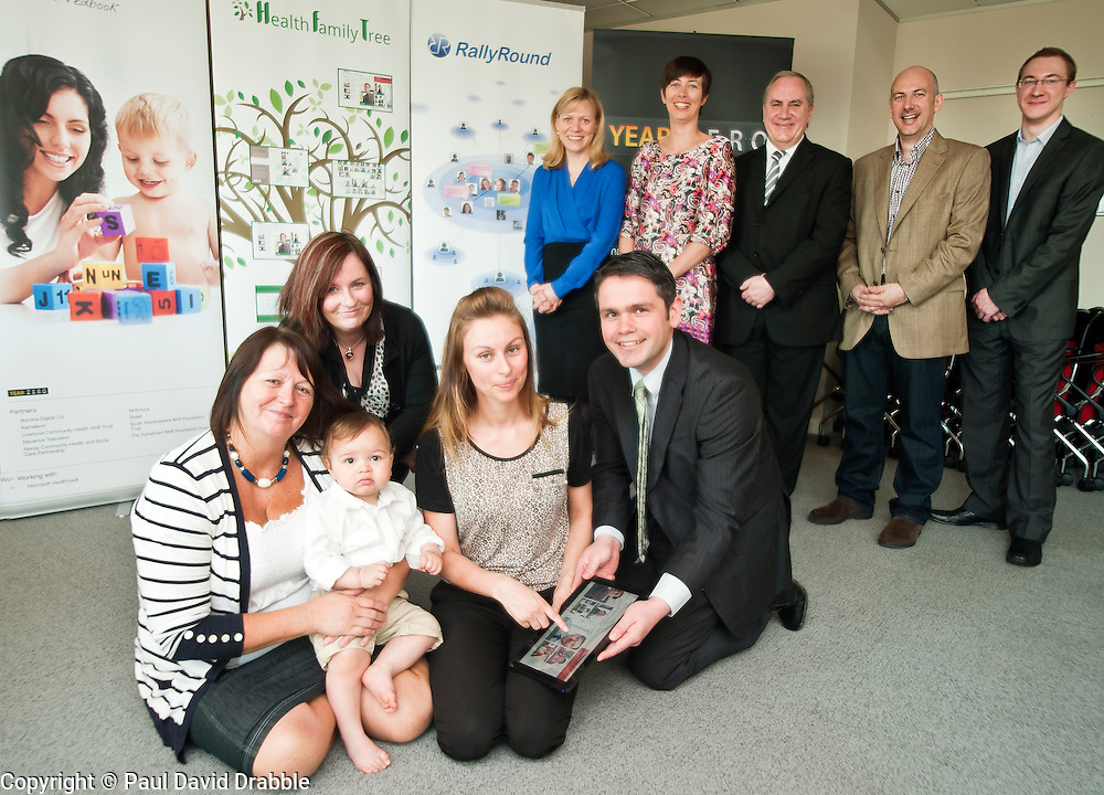Launch of Technology Strategy Board, Year Zero dallas Community at Rotherham NHS Foundation trust on Wednesday morning.From left to right front Gran Bet Rudge and Zac Roberts, Barbara Seaton of Rotherham Foundation trust, Mum Kirsty Rudge and Ben Chico of Rotherham Foundation trust with (standing left to right) Alison Shaw of Liverpool Community Health Trust, Alison Mlot dallas program manager with Technology Strategy Board, Brian James Chief exec Rotherham Foundation trust, David McGirr of Illumina Digital and Jason Brewster of Sitekit..23  May 2012.Image © Paul David Drabble