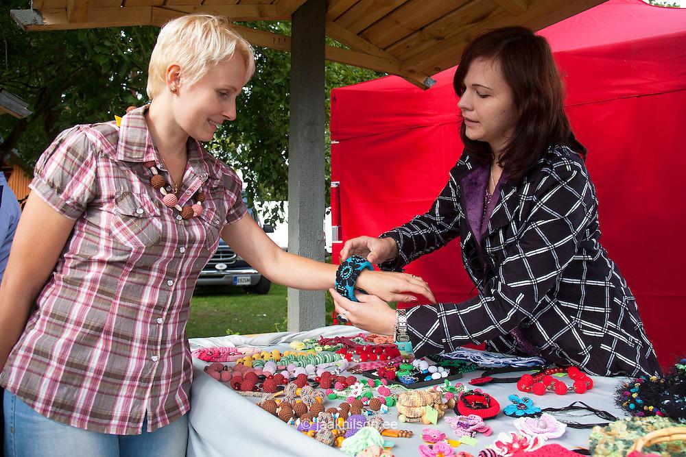 Young Woman Trying a Handmade Bracelet in Lüübnitsa Fair; Setomaa, Põlva County, Estonia