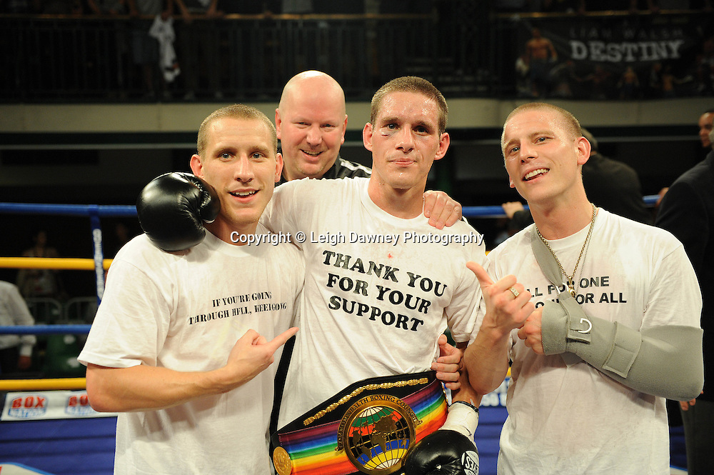 Liam Walsh (with brothers Ryan and Michael) celebrates defeating Paul Appleby for The Commonwealth Super-Featherweight Championship at York Hall, Bethnal Green, London on Friday 30th September 2011. Box Nation.tv's debut live TV Channel 456 on Sky. Photo credit: © Leigh Dawney. Queensberry Promotions.