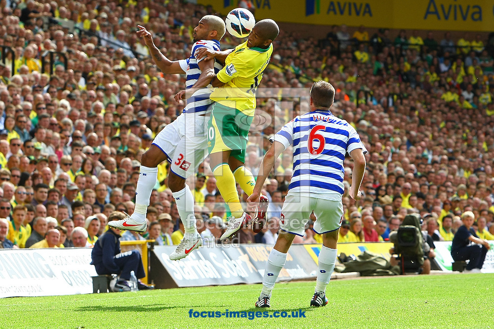 Picture by Paul Chesterton/Focus Images Ltd +44 7904 640267.25/08/2012.Armand Traore of QPR and Simeon Jackson of Norwich  in action during the Barclays Premier League match at Carrow Road, Norwich.