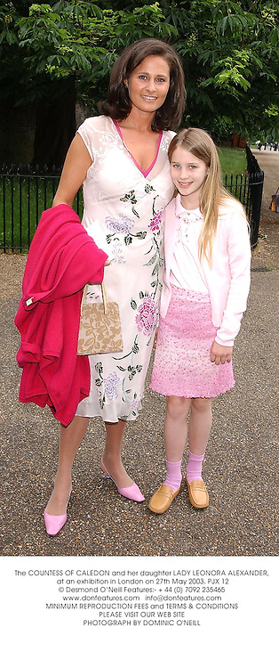 The COUNTESS OF CALEDON and her daughter LADY LEONORA ALEXANDER, at an exhibition in London on 27th May 2003.PJX 12