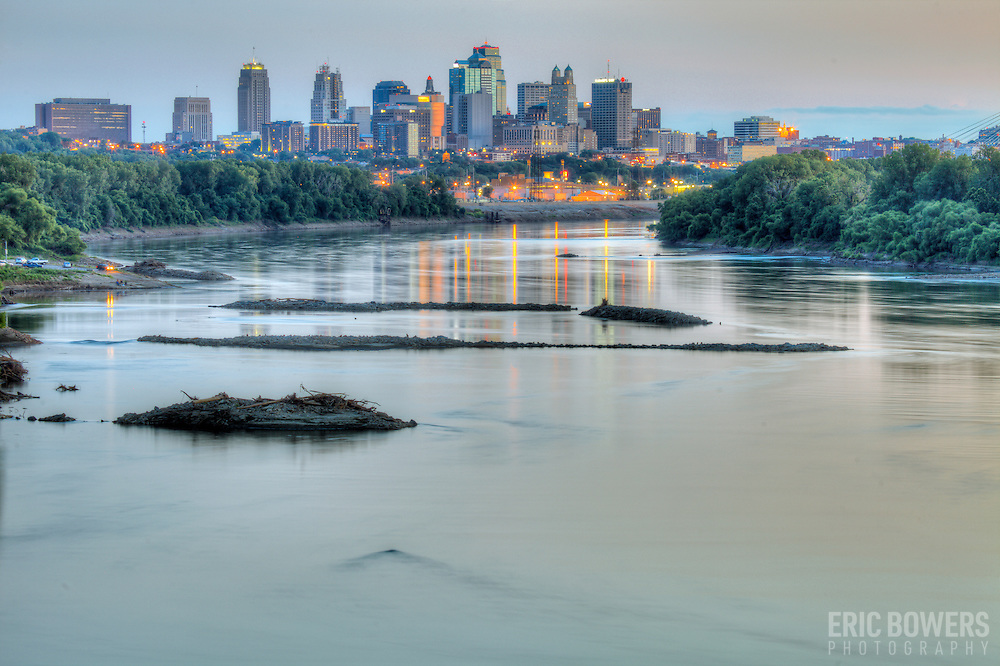 Kansas City Missouri downtown skyline and Missouri River view at dusk from Chouteau Trafficway Bridge.