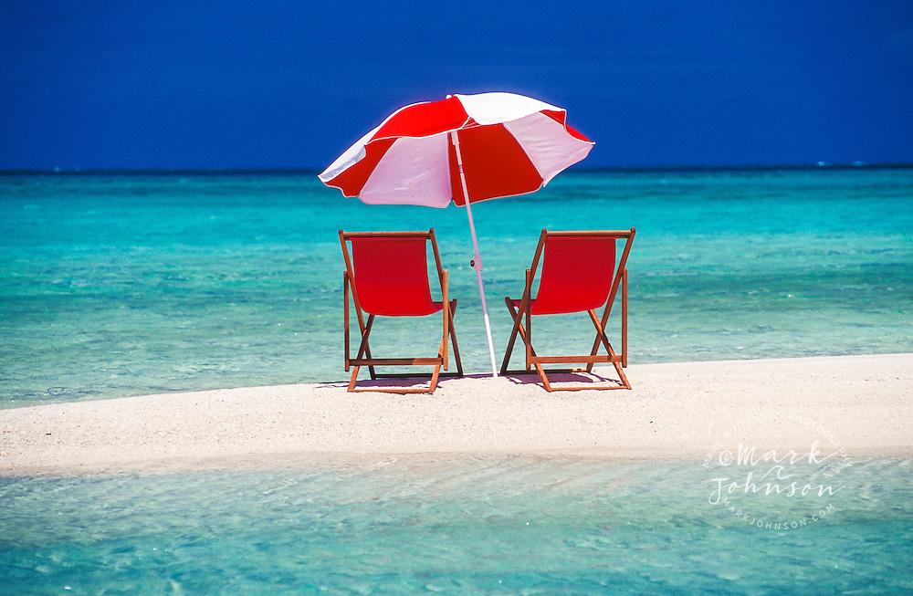 Beach chairs and umbrella, Lizard Island, Queensland, Australia