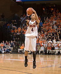 Virginia guard Calvin Baker (4) shoots an uncontested three pointer against NCSU.  The Virginia Cavaliers men's basketball team defeated the North Carolina State Wolfpack 78-60 at the John Paul Jones Arena in Charlottesville, VA on February 24, 2008.