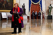 Senator Barbara Mikulski of Maryland checks her phone in the US Capitol Rotunda during the presidential inauguration, January 21, 2013.