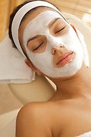 Close-up of young woman wearing facial mask