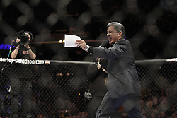 Dec 12, 2009; Memphis, TN, USA; Bruce Buffer announces the challenger Diego Sanchez during his bout at UFC 107 at the FedEx Forum in Memphis, TN.  BJ Penn retained his title when the bout was stopped on cuts in the 5th round.