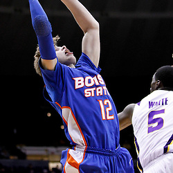 December 10, 2011; Baton Rouge, LA; Boise State Broncos guard Igor Hadziomerovic (12) shoots over LSU Tigers forward Malcolm White (5) during the second half of a game at the Pete Maravich Assembly Center. LSU defeated Bosie State 64-45. Mandatory Credit: Derick E. Hingle-US PRESSWIRE