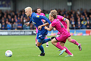 AFC Wimbledon striker Joe Pigott (39) taking on Rochdale defender Luke Matheson (41) during the EFL Sky Bet League 1 match between AFC Wimbledon and Rochdale at the Cherry Red Records Stadium, Kingston, England on 5 October 2019.
