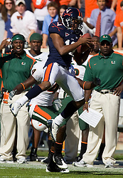 Virginia cornerback Chase Minnifield (13) intercepts a pass intended for Miami (FL) wide receiver Aldarius Johnson (4).  The Miami Hurricanes defeated the Virginia Cavaliers 24-17 in overtime in a NCAA Division 1 Football game at Scott Stadium on the Grounds of the University of Virginia in Charlottesville, VA on November 1, 2008.