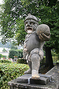 Austria, Salzburg, Marble baroque dwarf at the entrance to the Zwerglgarten in Mirabell gardens