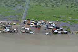 The Coast Guard assessed damage and offered search and rescue assisitance during an overflight from Port Aransas to Port O'Connor, Texas, Aug. 26, 2017. The Coast Guard is working closely with all local and state emergency operation centers to manage Coast Guard storm operations.<br /> <br /> U.S. Coast Guard photo by Petty Officer 3rd Class Johanna Strickland.