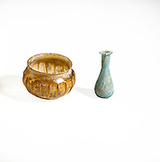 2 Roman glass containers one yellow one green first centuryBCE