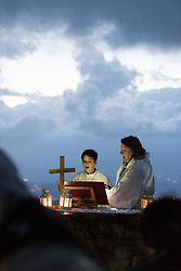 20 April 2019, Jerusalem: Carey Ballenger (left) and Jeni Falkman Grangaard (right) lead an Easter Sunday sunrise service at Jabal Allah (God's Mountain) on the Mount of Olives in Jerusalem, held by the Lutheran Church of the Redeemer (English-speaking congregation).