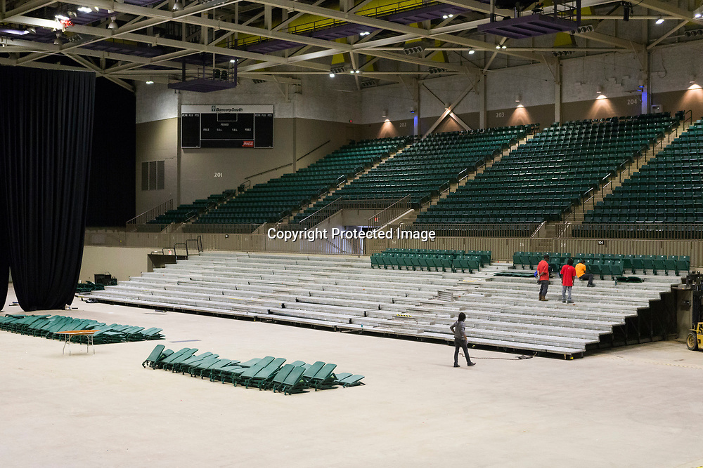 A crew works on unscrewing and piling up seats as they remove the lower bowl at the BancorpSouth Arena Tuesday morning.