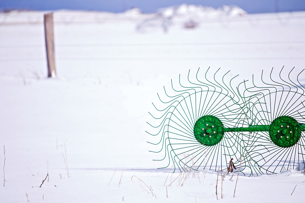 A set of hay rake wheels contrast the untouched snow that fell on the Rathdrum Prairie following the snowstorm early Wednesday.