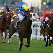 Australian horse Scenic Blast (blue and yellow) ridden by Steve Arnold winning The King's Stand Stakes, The British leg of the global sprint challenge, at Royal Ascot 2009, Ascot, UK, on Tuesday, June 17, 2009. Photo Tim Clayton.