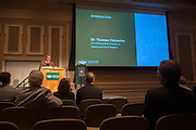 The 2013 Distinguished Professor, Dr. Thomas Carpenter, introduces Dr. Christopher France at the Dinstinguished Professor Portrait Unveiling and Lecture in Baker University Center Ballroom on Tuesday, March 10.