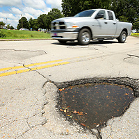Traffic moves the over potholes on Mall Drive on Monday as they enter The Mall at Barnes Crossing in Tupelo.