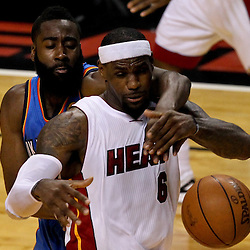 Jun 19, 2012; Miami, FL, USA; Miami Heat small forward LeBron James (6) has the ball knocked away by Oklahoma City Thunder guard James Harden (13) during the second quarter in game four in the 2012 NBA Finals at the American Airlines Arena. Mandatory Credit: Derick E. Hingle-US PRESSWIRE