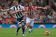 Stoke City midfielder Charlie Adam and West Bromwich Albion midfielder James McClean during the Barclays Premier League match between Stoke City and West Bromwich Albion at the Britannia Stadium, Stoke-on-Trent, England on 29 August 2015. Photo by Aaron Lupton.