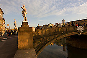 Wide landscape view of the Ponte Santa Trinita in Florence. Ponte Santa Trinita was constructed by the Florentine architect Bartolomeo Ammanati from 1567 to 1569. Its site, downstream of the equally remarkable Ponte Vecchio,[2] is a major link in the medieval street plan of Florence, which has been bridged at this site since the thirteenth century. The bridge was destroyed in 1944 by retreating German troops but reconstructed in 1958 with original stones raised from the Arno or taken from the same quarry, under the direction of the architect Riccardo Gizdulich and the engineer Emilio Brizzi.
