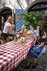 THEMENBILD - Biergarten, mit beginn des Fruehjahres, setzt auch wieder die Biergarten Zeit ein. im Bild bei Sonnenschein geniessen einige Personen leckeres Essen und kuehles Bier in einem Biergarten. Bild aufgenommen am 13.04.2013 in der Zeughaus Stuben, Augsburg, Bayern, Deutschland. Model release. EXPA Pictures © 2013, PhotoCredit: EXPA/ Eibner/ Peter Fastl ***** ATTENTION - OUT OF GER *****