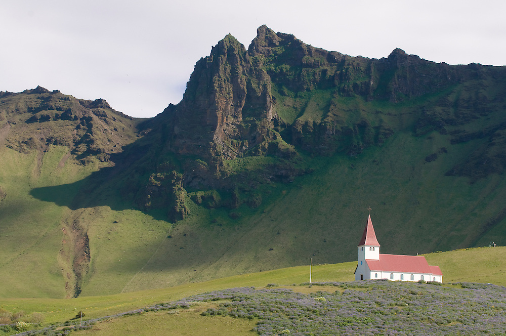 Church at bottom of mountain. Vik. Iceland.