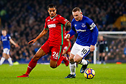 Swansea City defender Kyle Naughton (26) and Everton striker Wayne Rooney (10) contest the ball during the Premier League match between Everton and Swansea City at Goodison Park, Liverpool, England on 18 December 2017. Photo by Simon Davies.