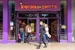 Edinburgh, Scotland, UK. 28 July, 2020. Business and tourism slowly returning to the shops and streets of Edinburgh city centre. Customers outside Kingdom of Sweets shop on Princes Street. Prime Minister Boris Johnson has announced campaign to reduce obesity in the country in an attempt to improve the Nations' health. Shops selling sugary products such as this do not help in this vision. Iain Masterton/Alamy Live News