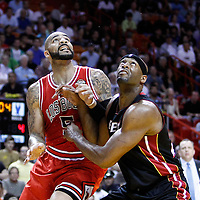 06 March 2010: Chicago Bulls power forward Carlos Boozer (5) vies for a rebound with `Miami Heat center Erick Dampier (25) during the Chicago Bulls 87-86 victory over the Miami Heat at the AmericanAirlines Arena, Miami, Florida, USA.
