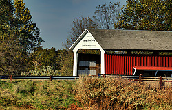 2015 Oct 19:   Parke County Indiana is the site of the Indiana Covered Bridge Festival every October.  This is the Thorpe Ford  It was built over Big Raccoon Creek on Catlin Road in 1912 and bypassed in 1961,  built by J.A. Britton. The bridge has a 163' span.<br /> <br /> This image was produced in part utilizing High Dynamic Range (HDR) processes.  It should not be used editorially without being listed as an illustration or with a disclaimer.  It may or may not be an accurate representation of the scene as originally photographed and the finished image is the creation of the photographer.