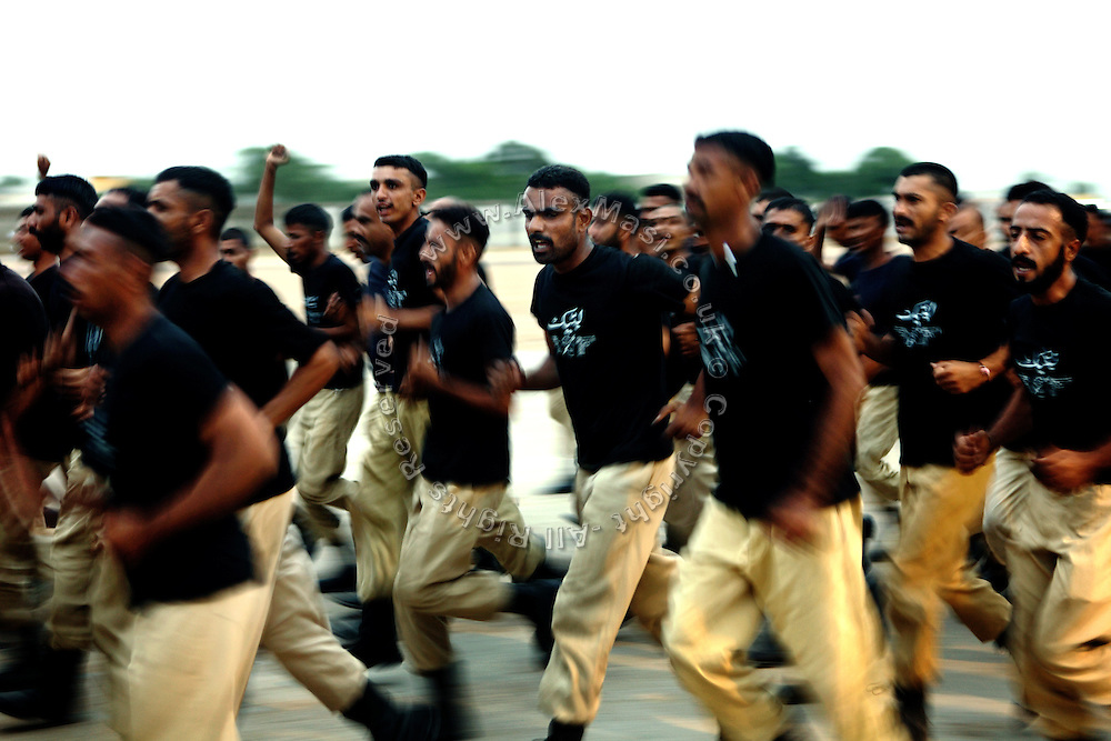 Recruits are running during training exercise at the Shaheed Benazir Bhutto Elite Police Training Center, a commando and anti-terrorism academy on the outskirts of Karachi. The training center was founded by retired colonel Abdul Wahid Khan, a brave officer who served as a gunship helicopter pilot in the Pakistani Air Force and around the globe with the United Nations, but who's first task as a young army officer in 1979 was to train Afghan Mujahedeen to fight the Soviet Army, the very Mujahedeen that are today's Taleban.