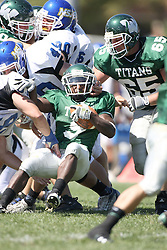 15 September 2007:  Marcus Dunlop looses his footing in a den of Lions. The Titans stood toe to toe with the 25th ranked Lions through the first half but ended the game on the losing end of a 25-15 score at Wilder Field on the campus of Illinois Wesleyan University in Bloomington Illinois.