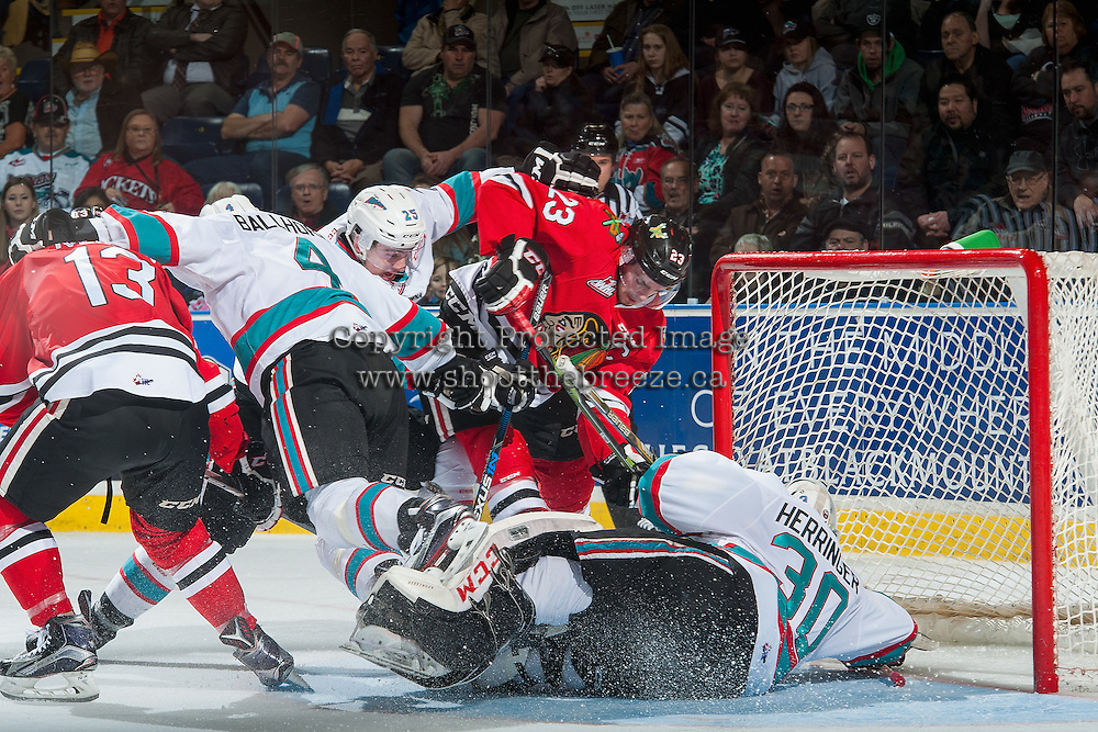 KELOWNA, CANADA - JANUARY 29: Dominic Turgeon #23 of Portland Winterhawks gets tangled up with Gordie Ballhorn #4, Cal Foote #25 and Michael Herringer #30 of Kelowna Rockets on January 29, 2016 at Prospera Place in Kelowna, British Columbia, Canada.  (Photo by Marissa Baecker/Shoot the Breeze)  *** Local Caption *** Michael Herringer; Gordie Ballhorn; Cal Foote; Dominic Turgeon;