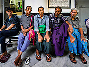 17 NOVEMBER 2017 - YANGON, MYANMAR: Muslim men sit in the entry way of a Shia mosque in Yangon.  Pope Francis is visiting Myanmar for three days in late November, 2017. He is participating in two Catholic masses and expected to address the Rohingya issue. The Rohingya are a persecuted Muslim ethnic minority in western Myanmar.        PHOTO BY JACK KURTZ