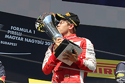 26.07.2015, Hungaroring, Budapest, HUN, FIA, Formel 1, Grand Prix von Ungarn, Rennen, im Bild Sebastian Vettel (Scuderia Ferrari) kuesst den Pokal // during the race of the Hungarian Formula One Grand Prix at the Hungaroring in Budapest, Hungary on 2015/07/26. EXPA Pictures &copy; 2015, PhotoCredit: EXPA/ Eibner-Pressefoto/ Bermel<br /> <br /> *****ATTENTION - OUT of GER*****