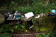 Household utensils pictured outside a caravan dwelling used by campaigners and residents of the Nine Ladies protest camp at Stanton Lees, near Matlock in the Derbyshire Dales. The ancient woodland and Nine Ladies stone circle were threatened by a proposed quarry near the site. Following a nine year campaign by protesters the quarry proposal has now been rejected, and the camp will soon be dismantled and vacated.
