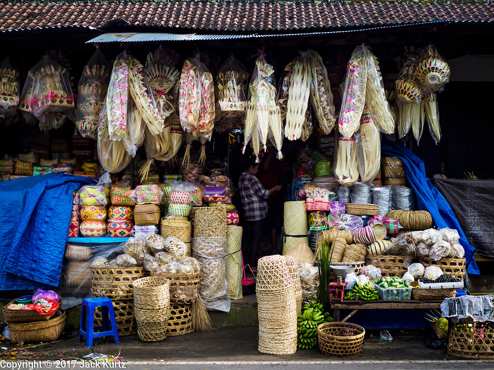 07 AUGUST 2017 - BEBANDEM, BALI, INDONESIA: Locally woven baskets for sale in the market in Bebandem, in far eastern Bali. The market is known for baskets, which are woven in the area. Bali's local markets are open on an every three day rotating schedule because venders travel from town to town. Before modern refrigeration and convenience stores became common place on Bali, markets were thriving community gatherings. Fewer people shop at markets now as more and more consumers go to convenience stores and more families have refrigerators.     PHOTO BY JACK KURTZ