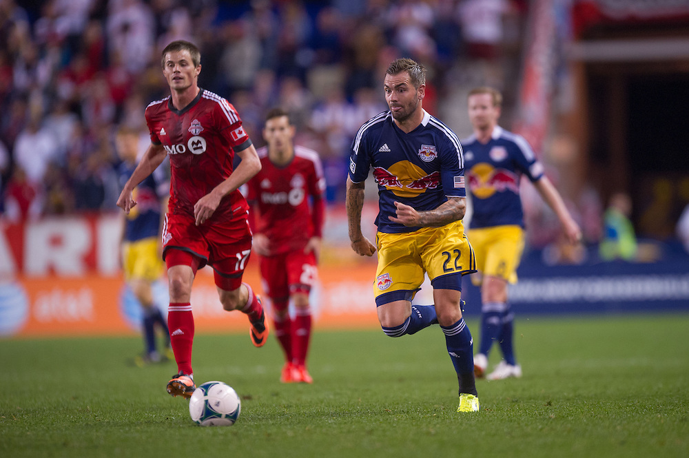 HARRISON, NJ - SEPTEMBER 14:  Jonny Steele #22 of New York Red Bulls dribbles the ball during the game against the Toronto FC at Red Bulls Arena on September 14, 2013. (Photo By: Rob Tringali)