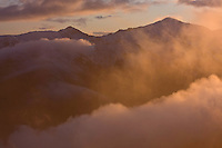 Clouds and fog and the mounts Vel'kà Kamenista (2121m asl) and Bystrà (2248m asl) at sunset. Western Tatras, Slovakia. June 2009. Mission: Ticha