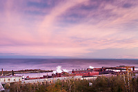 Silver Bay, MN - Sept 30, 2011 North Shore mining steel pellet processing plant on the shores of Lake Superior in Northern Minnesota with a pink sunset.