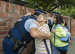 March 23, 2019 - Christchurch, Canterbury, New Zealand - Marchers hug a few police officers during a 'A March for Love' that was organized to unite the community in the wake of a terrorist attack on two city mosques that left 50 people dead. Thousands turned up to march from Hagley Park to the Botanic Gardens, which was organized by three teenagers (Credit Image: © PJ Heller/ZUMA Wire)